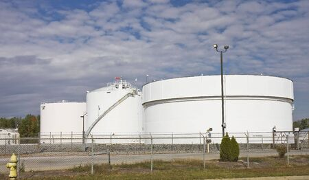 Massive white fuel tanks holding gasoline and diesel fuel