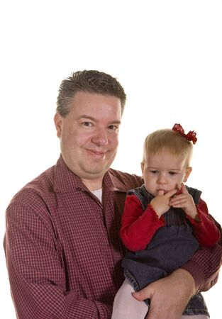 A young father with his small girl sucking in her fingers Stock Photo - 4052952
