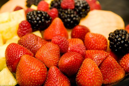 Fresh cut fruit and berries on a tray