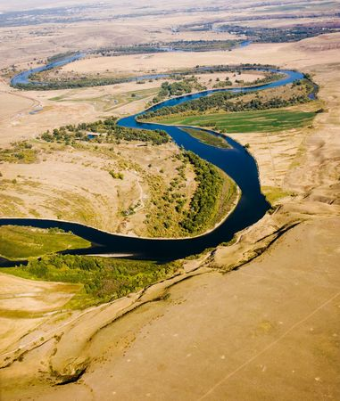 plains: A crooked blue river through the plains from above