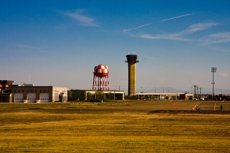 A control tower and water tower at a small regional airport Stock Photo