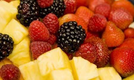 A delicious fruit platter of pineapple, blackberries, raspberries, and strawberries Stock Photo - 4151940