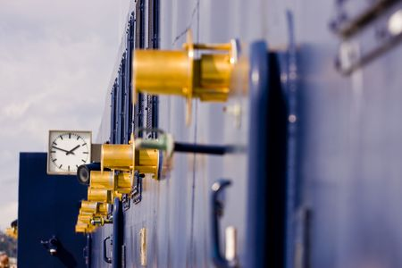 Gold Fixtures on the side of Blue Cruise Ship