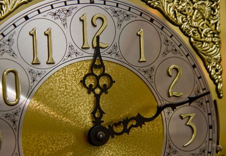 timely: Face of an old grandfather clock showing twelve-twelve