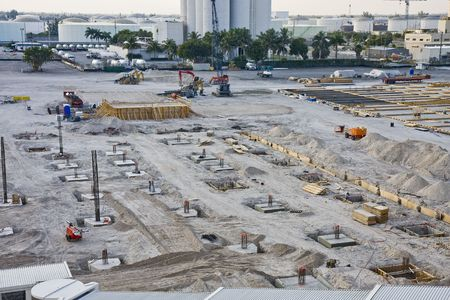 A large construction project coming out of the ground in an industrial area