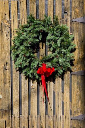 A Christmas wreath on an old barn door