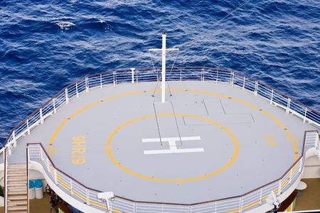 helicopter pad: A helicopter landing pad on the front of a cruise ship Stock Photo