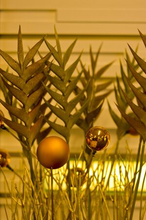 Gold ornaments in a Christmas decoration
