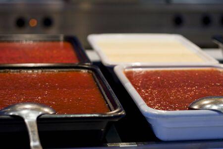 Hot fresh pasta sauces at a pasta bar