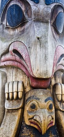 A giant colorful wood inuit totem pole