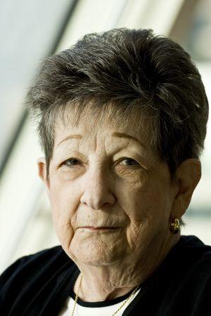 An older woman sitting by a window