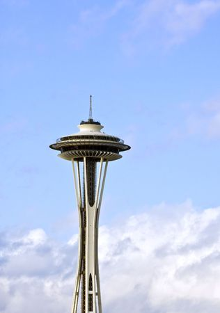 The space needle in Seattle rising from the clouds