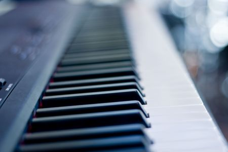 focused: Closeup of a piano keyboard  focused on black keys