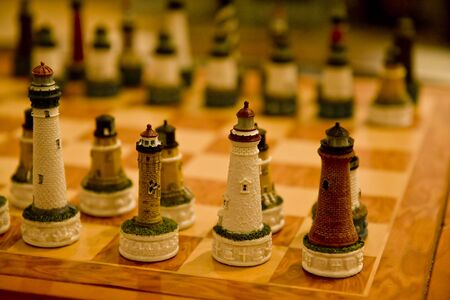 A carved wooden chess set in the shape of lighthouses Stock Photo - 4666962