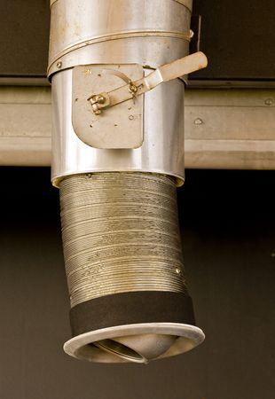 A flexible metal exhaust vent with a valve in the open position Reklamní fotografie