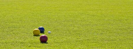 bocce: Bocce balls on a green grass lawn Stock Photo