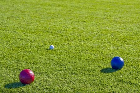 bocce: Colorful bocce balls on a green lawn Stock Photo