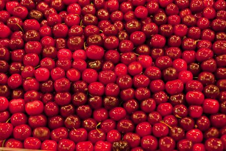 background: A background of ripe delicious red cherries
