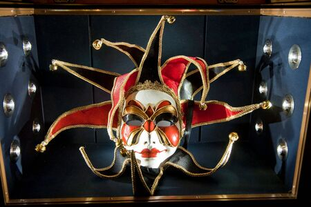 venice: A colorful mask from venice italy in a case Stock Photo