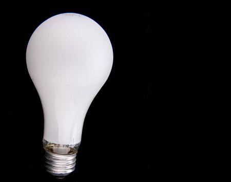 A white light bulb on a black background