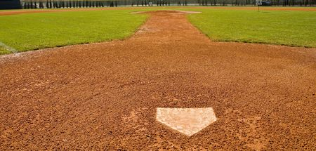 A baseball base in a newly planted and landscaped sports field photo