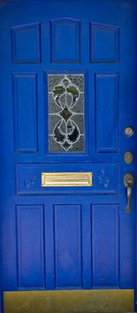 A bright blue door with ornate trim and hardware Фото со стока
