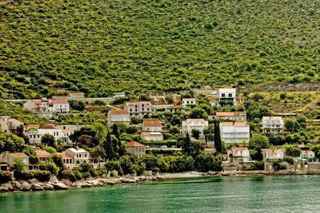 Colorful buildings on the green coast of Croatia