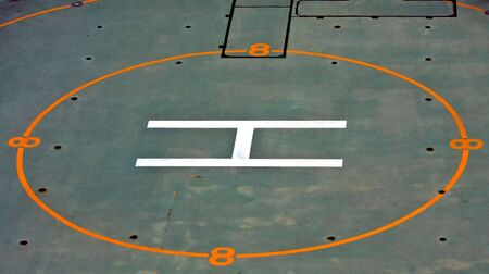helicopter pad: A helicopter pad on the deck of a ship