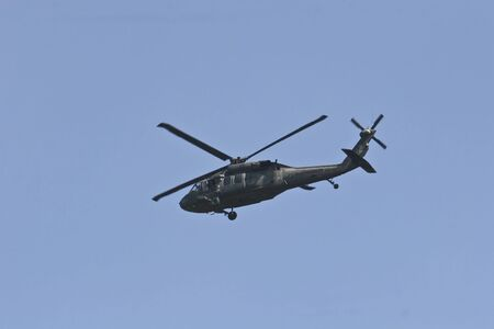 A Blackhawk Helicopter against a blue sky