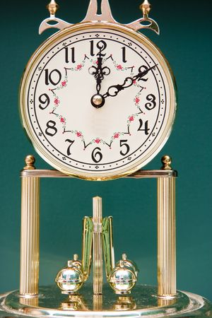 A classic anniversary clock against a green background