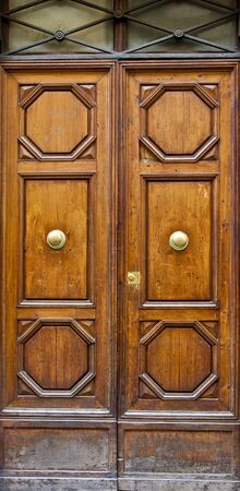 Old dusty doors with ornate carving and brass fixtures 版權商用圖片