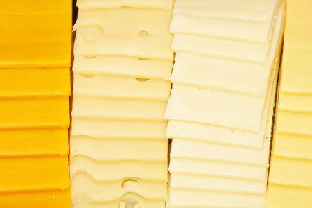 デリ ・ カウンターでスライス チーズの 4 種類 写真素材