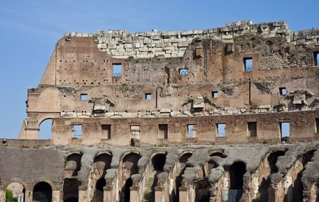 The walls of the ruins of the ancient coliseum in rome italy Banco de Imagens