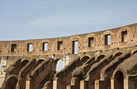 View of arches and walls at the ancient coliseum in rome, italy