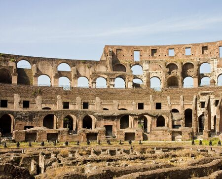 The walls and arches of the ancient coliseum in Rome, Italy Banco de Imagens - 5595125
