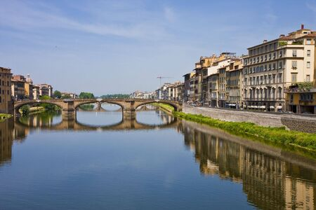 A bridge over the arno river in florence italy