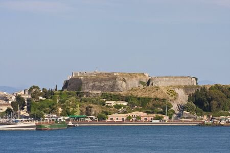 An old fort on a greek island overlooking the town Banco de Imagens
