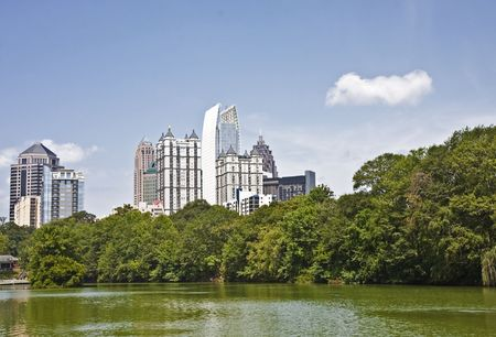 A view of the Atlanta Skyline shot from Piedmont Park with reflections in lake Фото со стока
