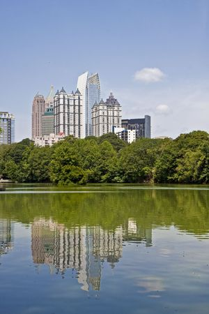 A view of the Atlanta Skyline shot from Piedmont Park with reflections in lake Stock Photo - 5780956
