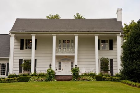 traditional: An old white colonial house with columns Stock Photo