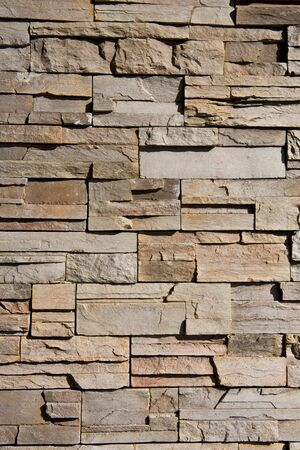 A wall of cut and stacked stone great for backgrounds or texture