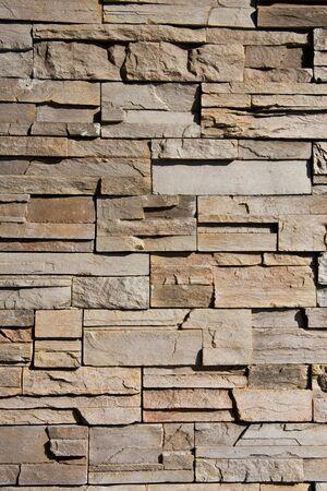 Een muur van knippen en gestapelde steen geweldig voor achtergronden of textuur