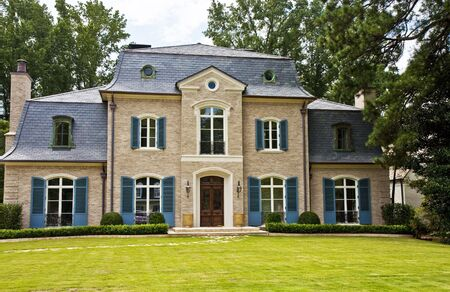 luxuries: A large mansion on a well landscaped lot