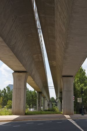 A view from under twin concrete bridges for a rapid rail system