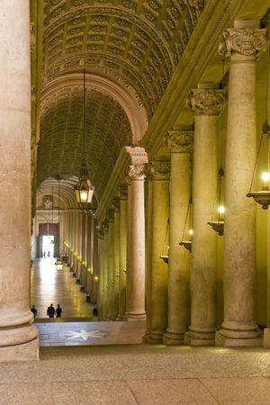 passageway: A passageway through the Vatican lined with columns Stock Photo