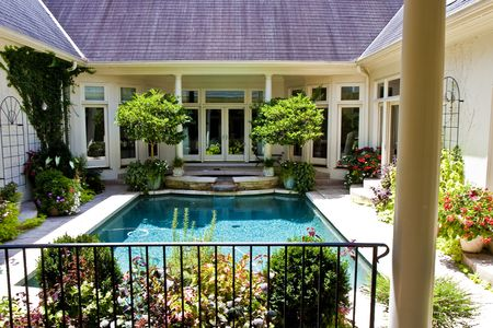 A beautiful pool in the courtyard of a nice house Banco de Imagens
