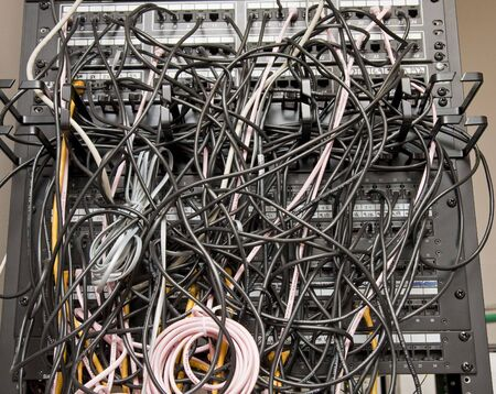 Telephone patch panel with tangled telephone cords photo