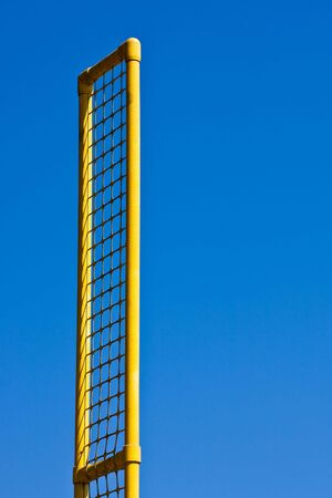 foul: A foul line pole at a baseball field against blue sky Stock Photo