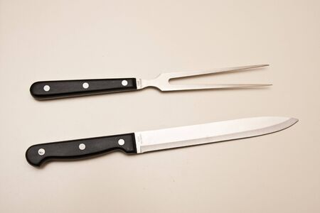A stainless steel knife and fork carving set