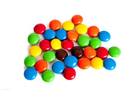 colored: Round Colored Candy on a White Background Stock Photo